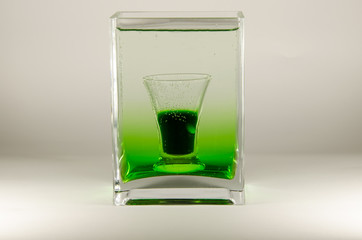 Glass of absinthe, abstract vase