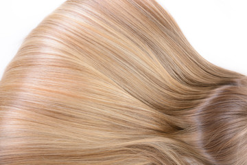 Hair and haircare. Beautiful blond female natural hair closeup