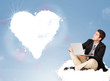 Handsome man sitting on cloud with heart