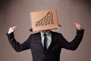 Businessman gesturing with a cardboard box on his head with diag