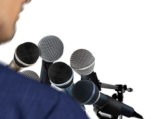 Man Giving Speech Using Microphones