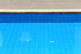 Abstract blue ripple water in swimming pool