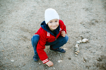 Little boy playing on road