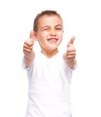 Happy boy is showing thumb up gesture