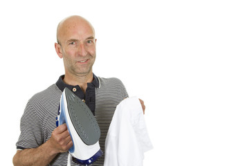 Man with bemused expression holding an iron and shirt