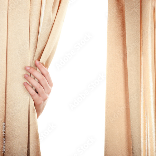 Hand opening curtain on white background