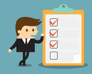 Businessman with clipboard and checklist