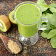 Green smoothie made with kiwi, spinach and banana