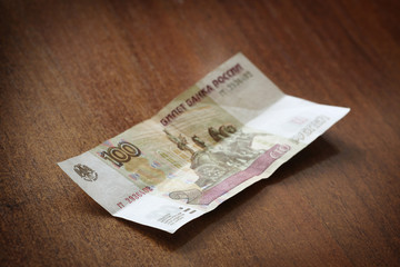 Russian banknote on a wooden table