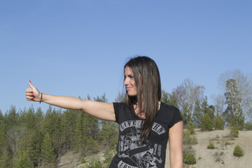 Gorgeous Woman showing thumbs up (hitchhiking)