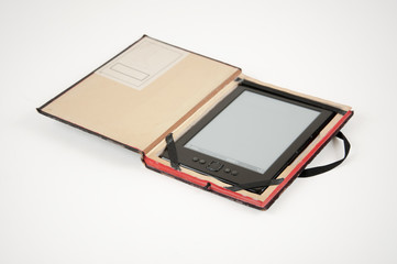 E-book reader in a case made of an old book