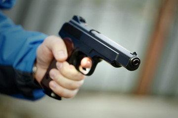 Man holding a gun. Vignetting.