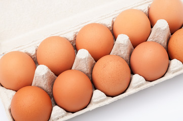 Brown eggs in egg box. Closeup