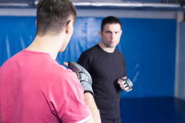 men at mma training