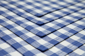 Napkins in blue cage lined background