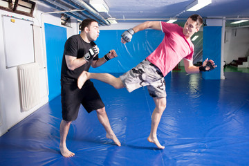 leg kick in the belly during martial art training