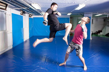 knee kick during mixed martial art training