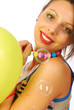 Beautiful girl dynamic and cheerful between balloons and soap bu