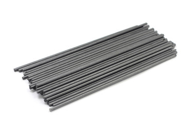 Black extruded graphite rods on a white background