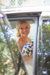 Beautiful bride in car