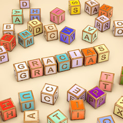 Color cubes with letters and word GRACIAS. Palabra GRACIAS.