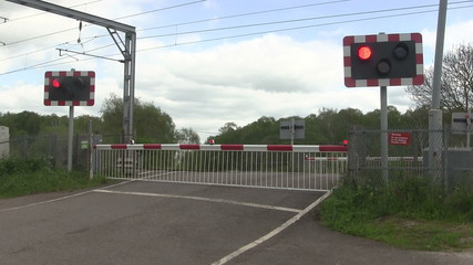 Red flashing lights at a level crossing.