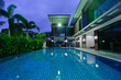 Modern house with swimming pool at night - 64514411