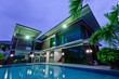 Modern house with swimming pool at night - 64514416