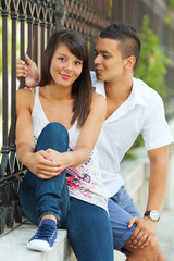 Young teenage couple relaxing in the city street