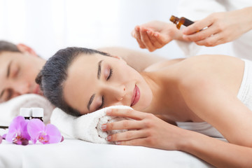 Couple having a spa treatment