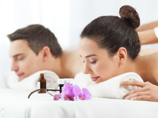 Young couple having aromatherapy massage in a spa.