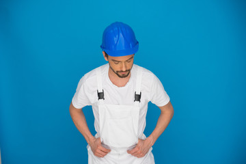 Workman in a blue hardhat