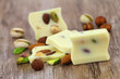White chocolate pieces with almonds, pistachios and hazelnuts