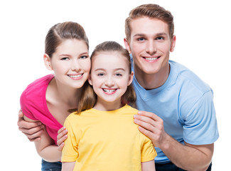 Portrait of the happy young family with child.