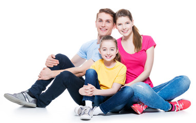 Happy young family with kid sitting.