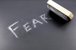 The word FEAR being erased from a chalkboard