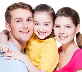 Portrait of happy smiling young family with kid.