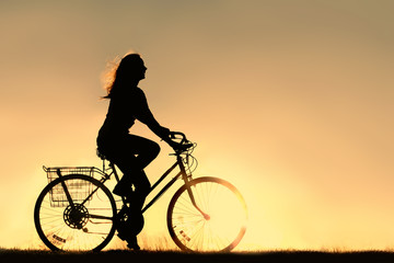 Woman Riding Bicycle Silhouette