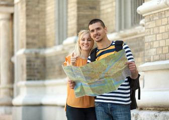 Couple with map in city