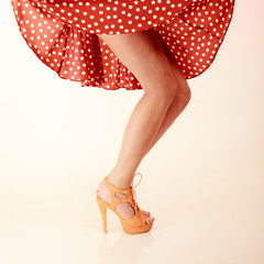Pinup style. Sexy female legs in dance.