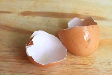 broken eggs on cutting board