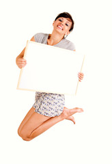 beautiful young woman jumping with blank poster