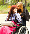 teen girl on the wheelchair with her friend