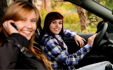 girl friends sitting in the car
