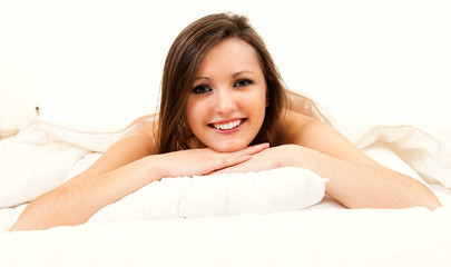 beautiful young woman in the bed