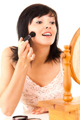 young lady applying make up