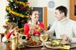 Portrait of Happy family of three celebrating Christmas