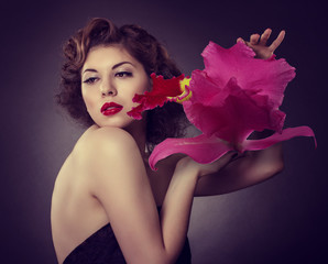 Beautiful woman with a big red flower in hand