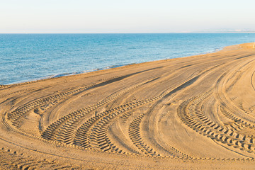 Tyre tracks on a beach