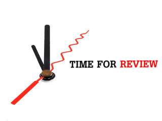 time for review concept clock closeup on white background